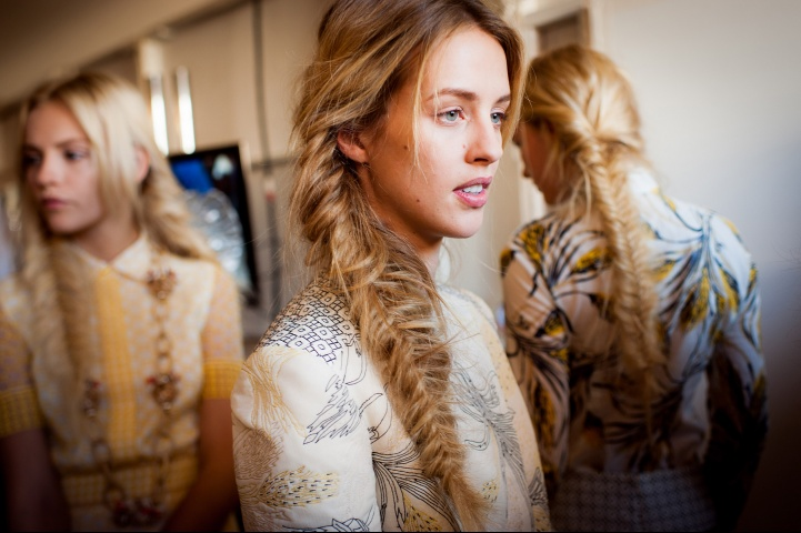 foxontherun :      vogue :     Backstage at Tory Burch spring 2013   Photographed by Mimi Ritzen Crawford    Go to Vogue.com for the full collection and review.       mmmmmm fishtail braids.