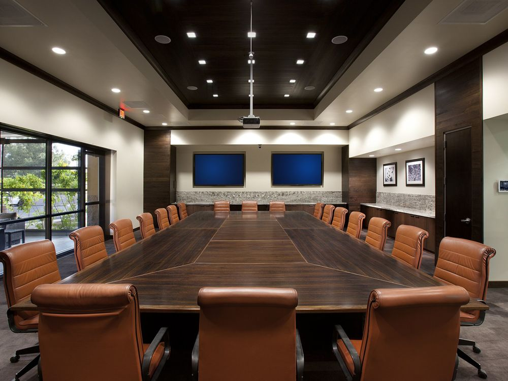 An executive conference room with reused furniture is featured in the newly opened Leslie's Swimming Pool Supplies building.    (Photo: Dino Tonn Photography)