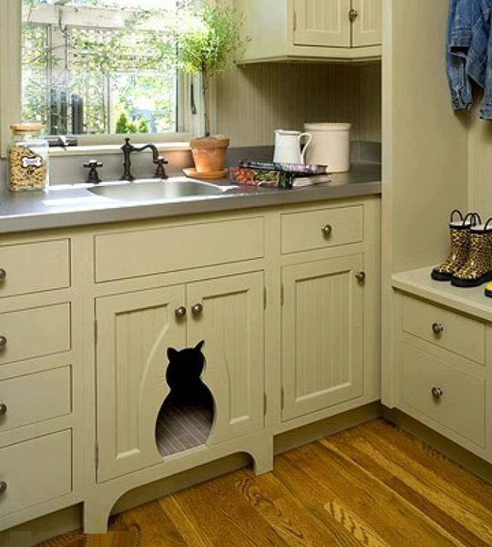 Our pets are forever becoming entangled under our feet in the kitchen, might as well give in and make them their very own kitchen nook.