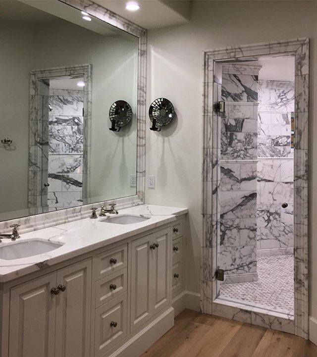Entire house renovation in Del Mar Country Club is wrapping up with the master bath and marble shower. Antique sconce lights by @chandelierfinelighting  ___________________________ #interiordesign #residentialdesign #marble #masterbath #renovation #delmar #ranchosantafe #annesneedarchitects #annesneedinteriors