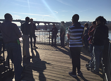 Students look out over the James River.