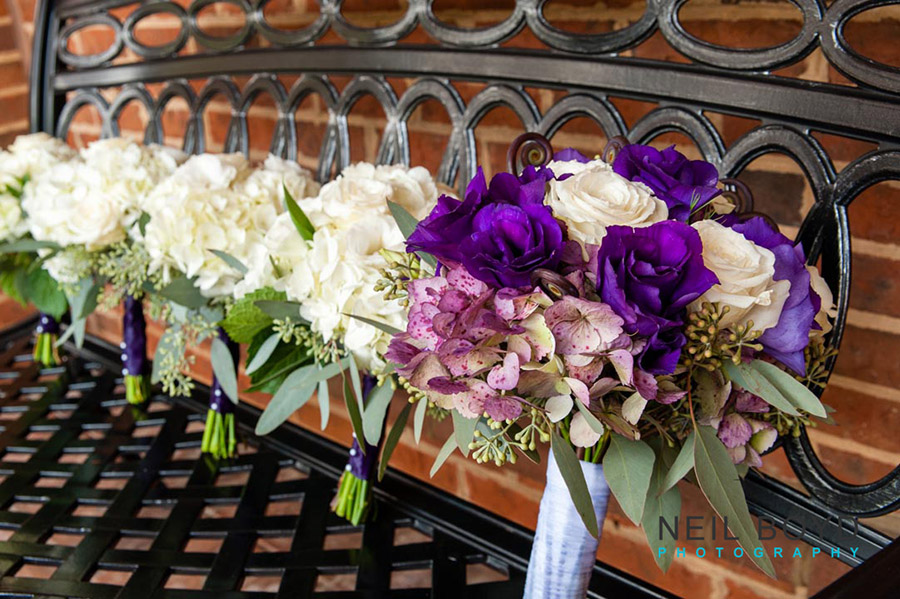 Purple & White Wedding Bouquets on Bench  | Raleigh Wedding Florist
