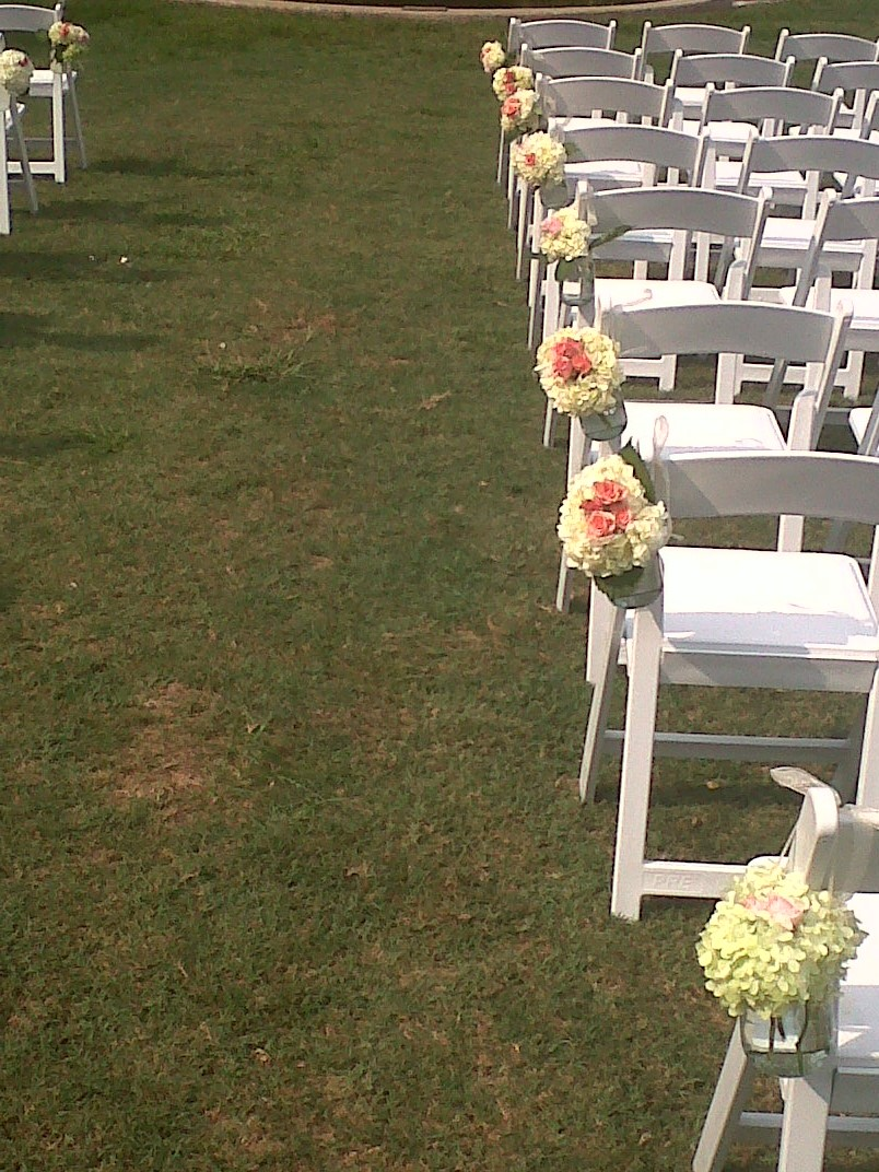 Outdoor wedding flowers - Isle chair bouquets