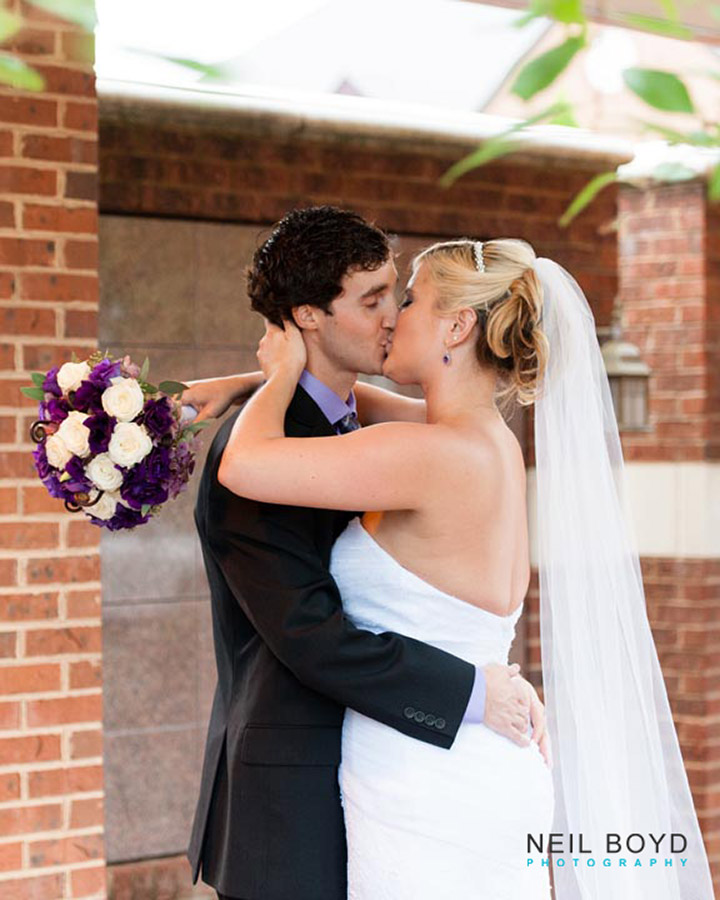 Kissing Bride and Groom  | Raleigh Wedding Florist