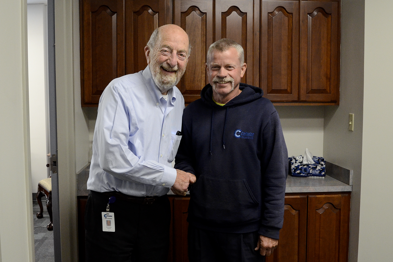 Celadon Founder and Chairman of the Board, Steve Russell, shakes hands with 30-year Celadon driver, Jerry Irvine.