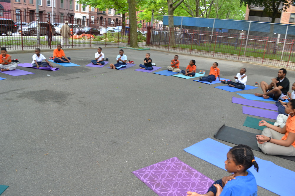 Hosh Yoga KIds teaches Yoga and works with students on physical and mental control.