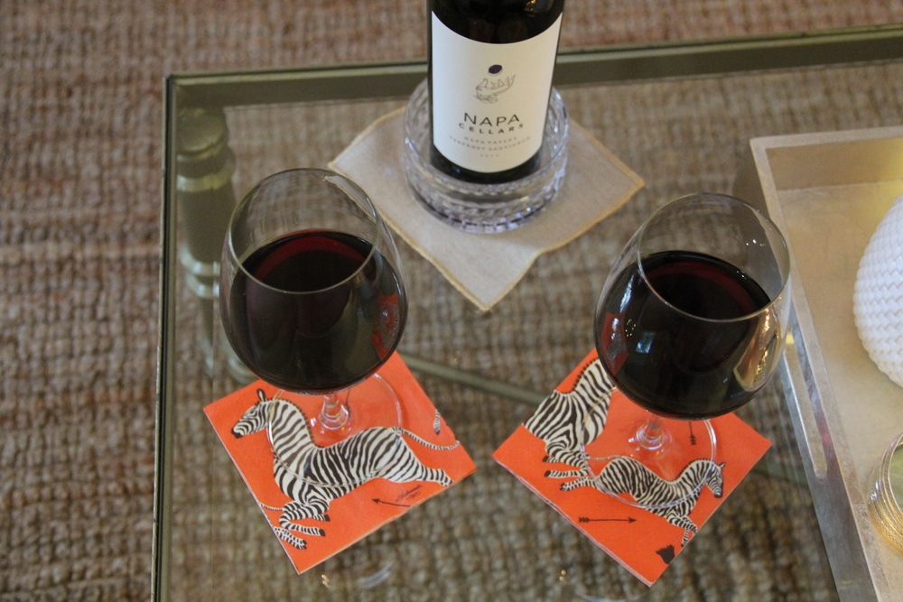Red Wine Glasses from World Market  are paired with the Orange Zebra Caspari Cocktail Napkins