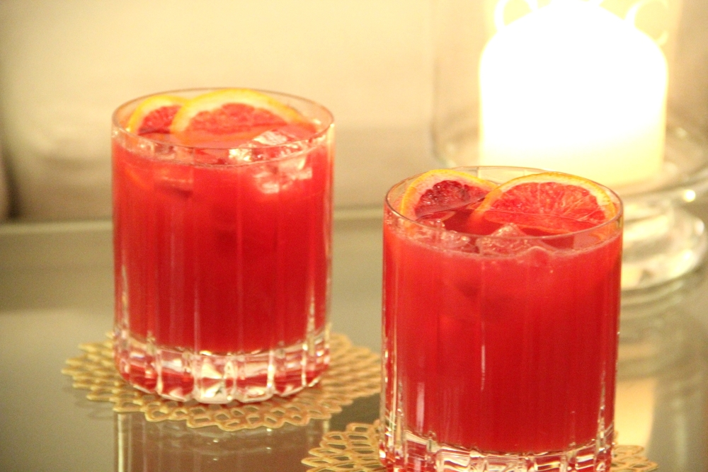 Blood Orange & Cranberry Cocktail garnished with Frozen Blood Orange Slices