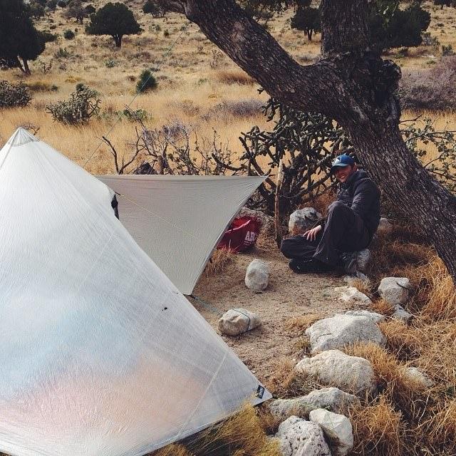 Ken watching Thomas set up his tarp at our car camping spot