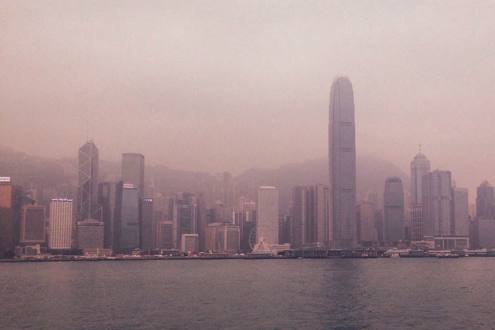 A hazy Hong Kong skyline.