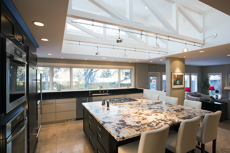 Andrea Residence  Calgary  A gorgeous kitchen renovation designed first and foremost to catch more natural daylight. A neutral finish palette ties the whole house together and an over sized island allows for large gatherings.