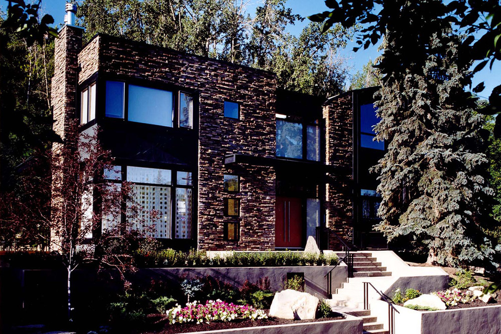 Wright Residence  Roxboro, Calgary 2000  Despite the constraints of an odd shaped lot, this ARIDO award winning  residence in Rideau Park encourages the flow of natural light and views of the surrounding landscape.
