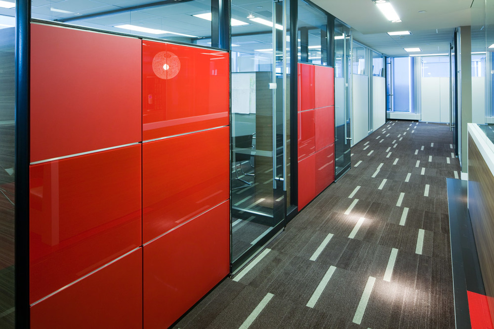 Baytex Energy Corp  Centennial Place, Calgary 2009  A high-contrast tenant improvement that uses colour and variations in material finish to break-down long interior corridors and provide way-finding. Clerestory glass is used to make rooms feel larger.
