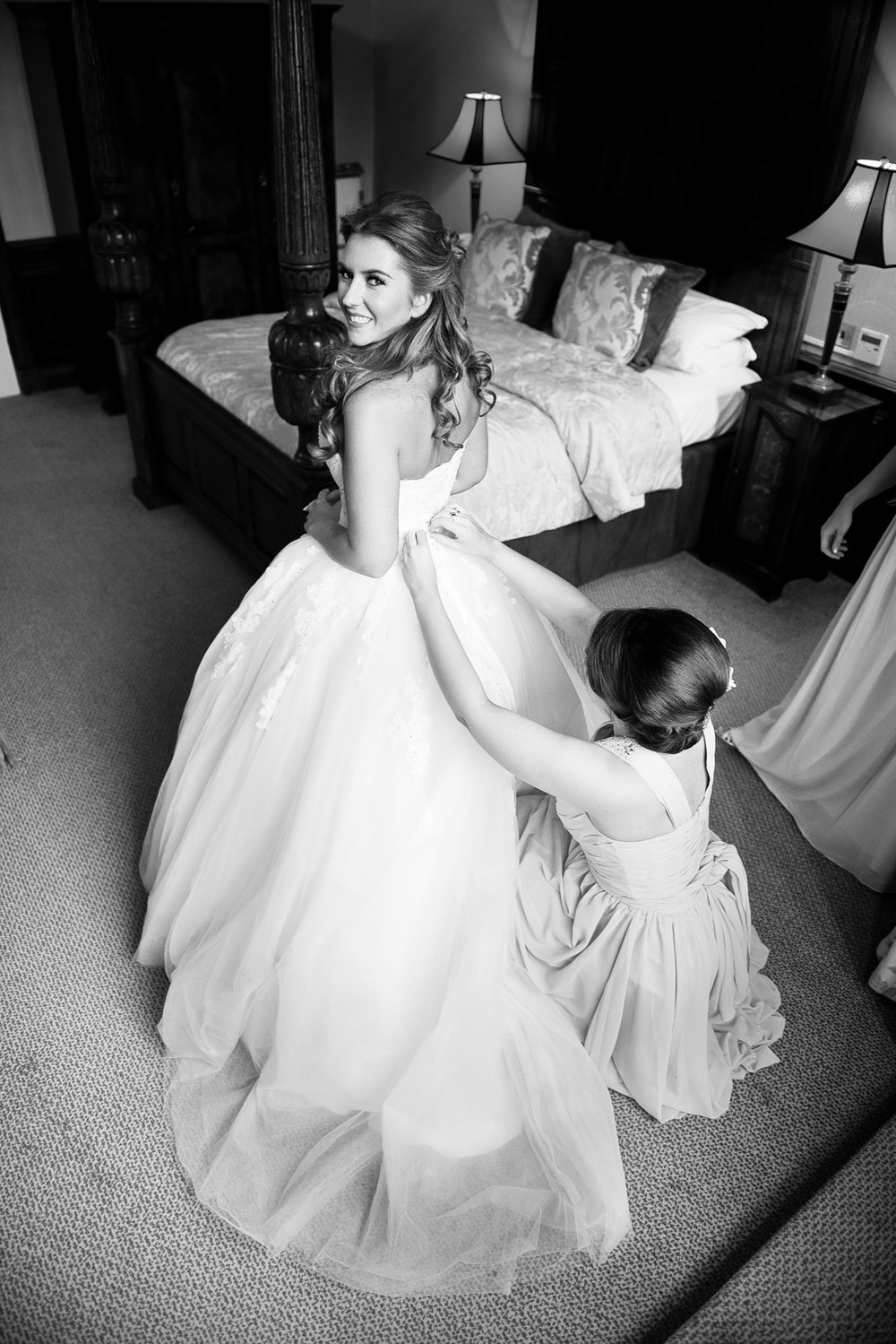 Spending time in the bridal suit with the bride and her bridesmaids produces pictures which reflect the excitement and emotion