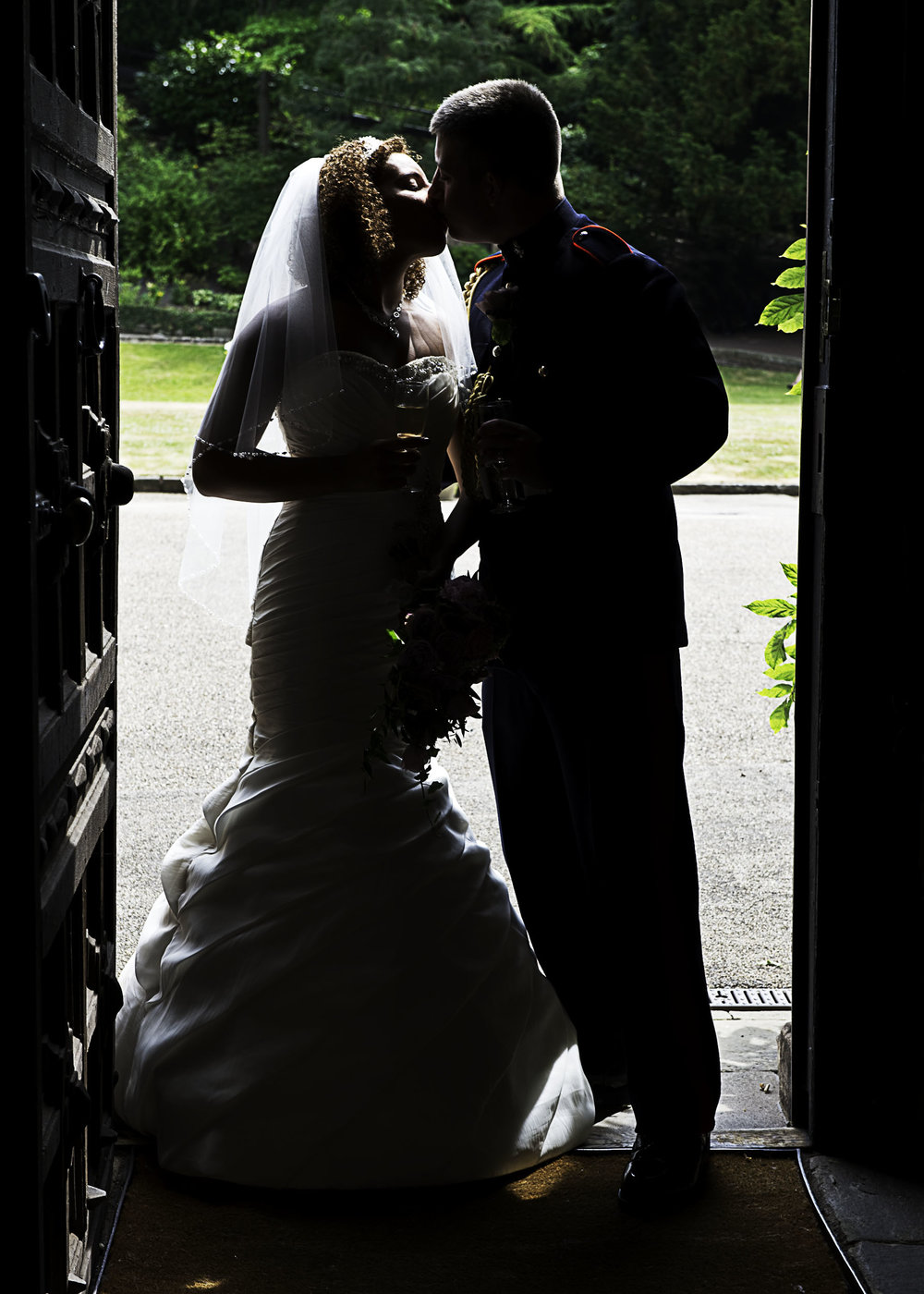A wedding photographer can use natural light as well as flash lighting. This silhouette has enough detail to add to the interest in the picture.