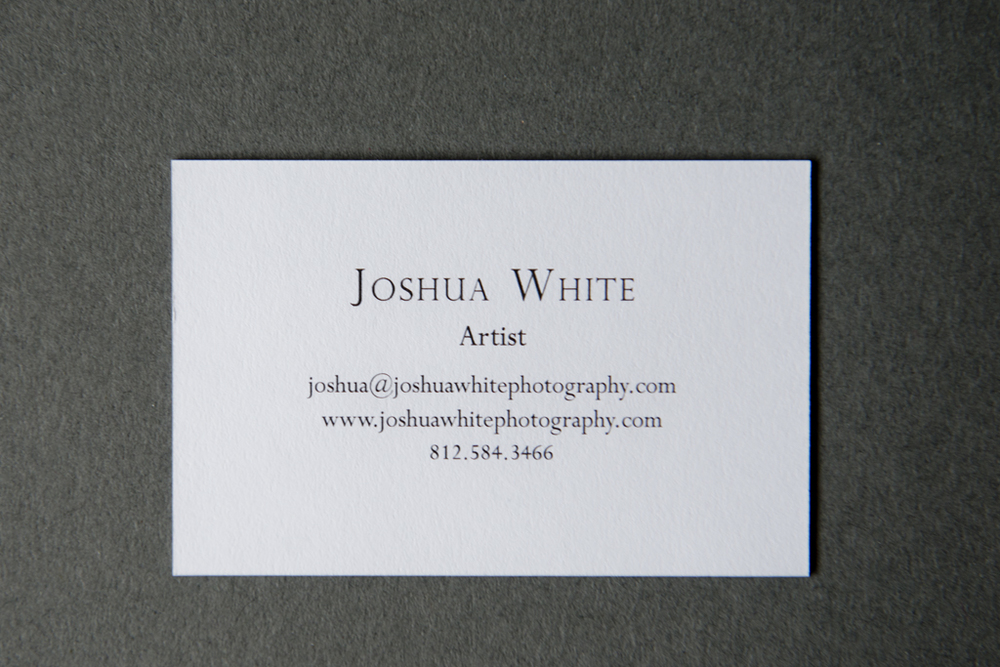 Joshua White's business cards are minimal and elegant, just like his photographs. Printed with Moo's luxe line, the multi-ply white textured paper contains a black core that makes them not only sturdy, but also ties in with the text color. His logo, a simple serifed 'W', is prominently displayed on one side with just the essential contact information on the other. The small-serif font is classic rather than modern, fitting with both the rich paper and his imagery.  Joshua White's limited edition print was released this month as part of Don't Take Pictures' print sale.