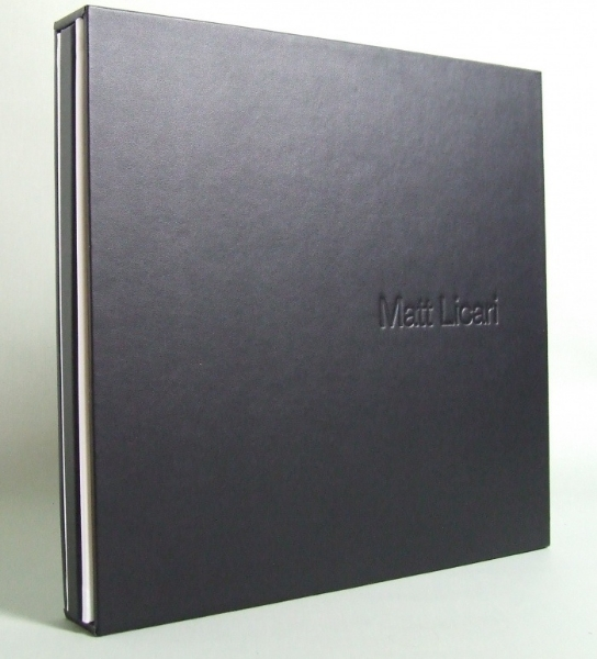 Matt Licari seamlessly blends his personal portraits with his fashion and editorial photography in his promo book. Portfolio books are a must-have in commercial photography and a great book will stand out from the pile on an editor's desk. Licari's white Italian leather bound book comes in a black slipcase with his name embossed on the front. The black and white color scheme is consistent with the rest of his promotional materials.