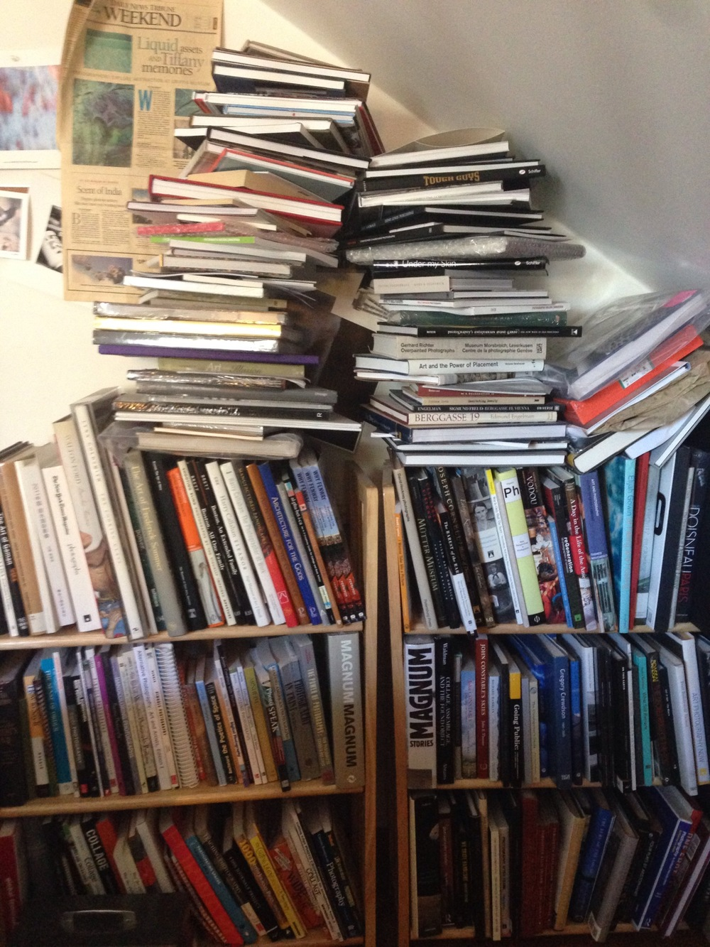 Paula Tognarelli's towering heap of books.