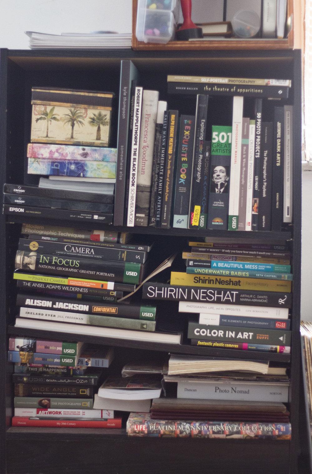 Etta Martin's precarious photobook piles.