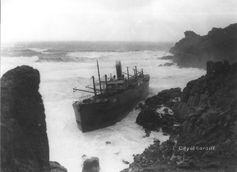 City of Cardiff, a British steamer, was traveling from France, to Wales when it wrecked in Mill Bay near Land's End in 1912. All of the crew were rescued.