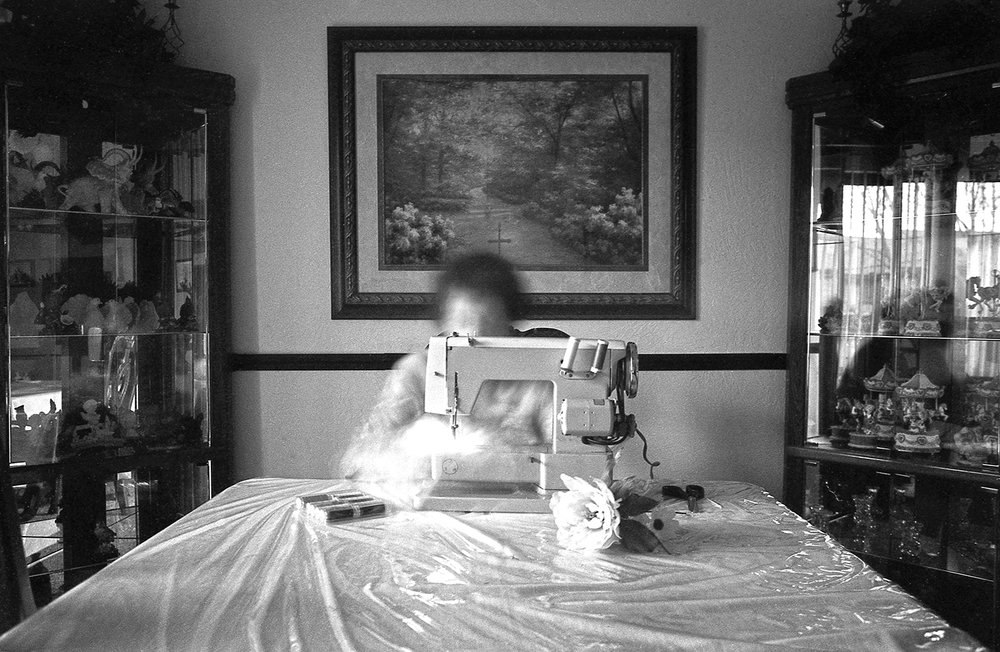 Evelyn Saldana and Her Sewing Machine  from the series  It Is What it Is ,  Jordan Gale