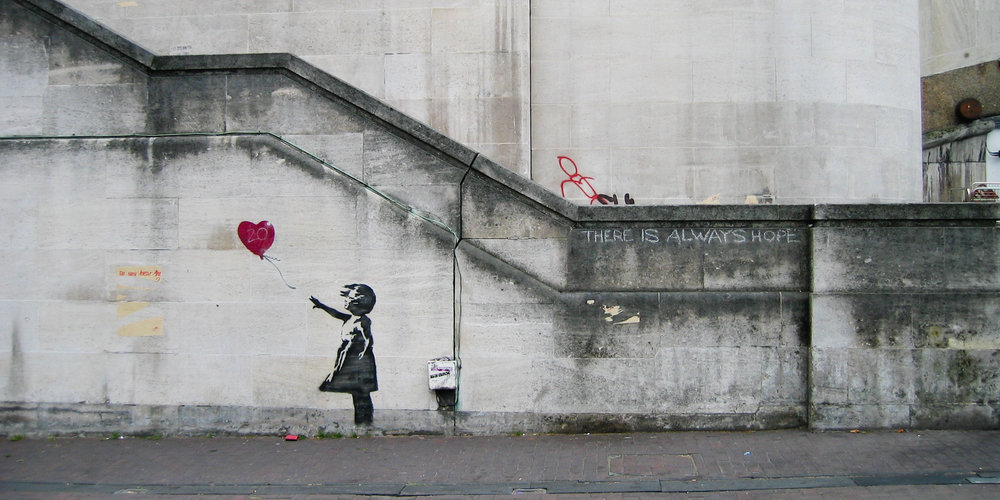 "Banksy's ""Balloon Girl"" Photo by Dominic Robinson via  Flickr  creative commons"