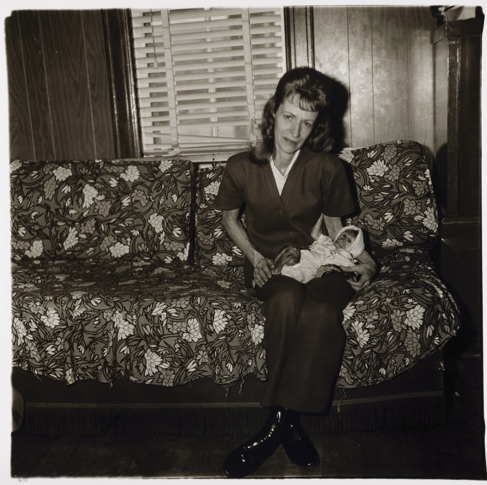 Diane Arbus,  A woman with her baby monkey, N.J. 1971 , 1971, gelatin silver print, 14 7/8  x 15. Smithsonian American Art Museum; Museum purchase. ©The Estate of Diane Arbus