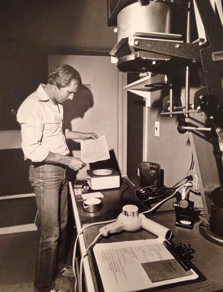 George Tice hand-coating paper for a palladium print in his home darkroom. Photo: Groenfeldt, 1982