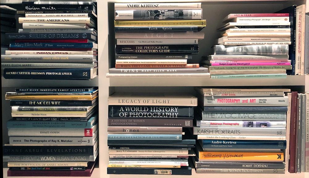 Neat stacks in  Gloria Baker Feinstein 's library.