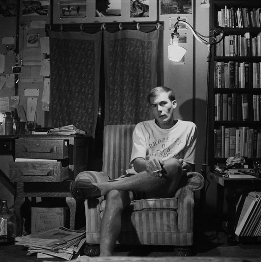 Hunter S. Thompson, Self Portrait, in Striped Chair, ca. 1960.