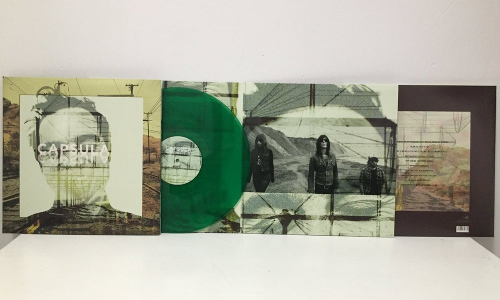 CAPSULA - LP - 2012 Reedition - Transparent Green Jade Vinyl - ALBUM YEAR 2002 BY DDT DISKAKREEDition 2012 Format: Vinyl, LP, MINT, Label: HOTSAK Country: SPAIN Date: 2002, Genre: Rock Style: Garage Rock, Psychedelic Rock