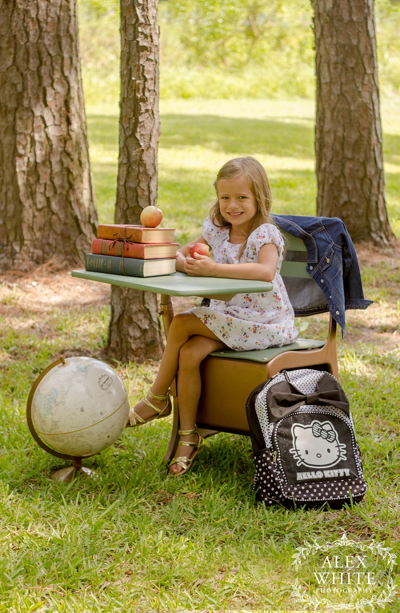 Mom brought their backpacks to the shoot. She also brought a snack with her - apples, the perfect snack for back to school!