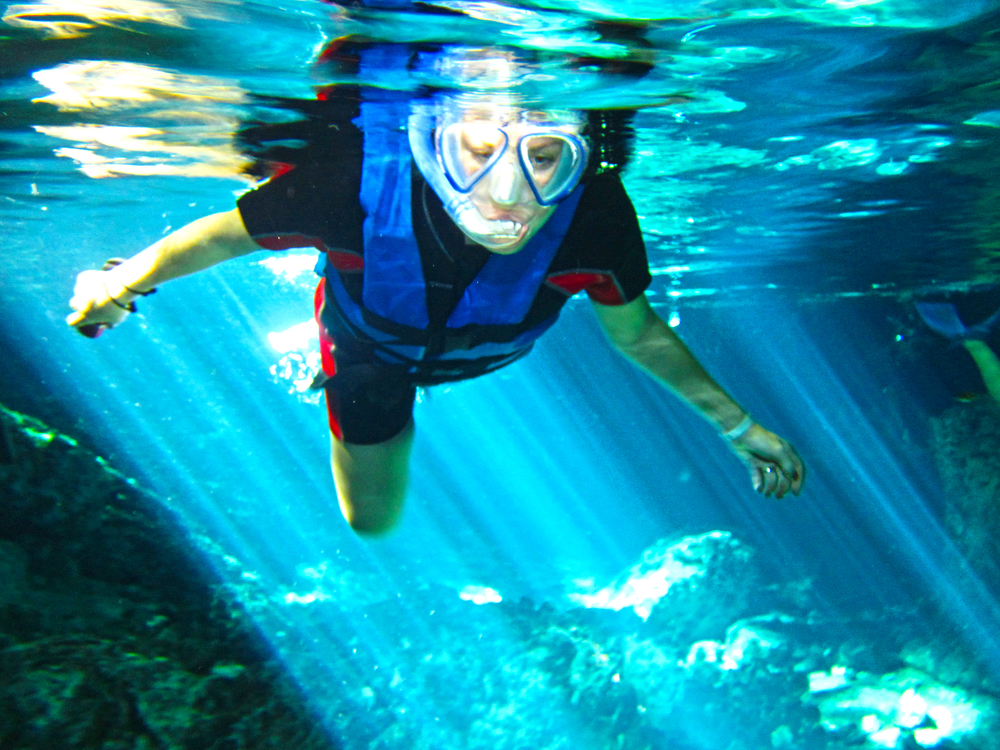 Snorkeling for the first time in the Dos Ojos Cenote, Mexico.