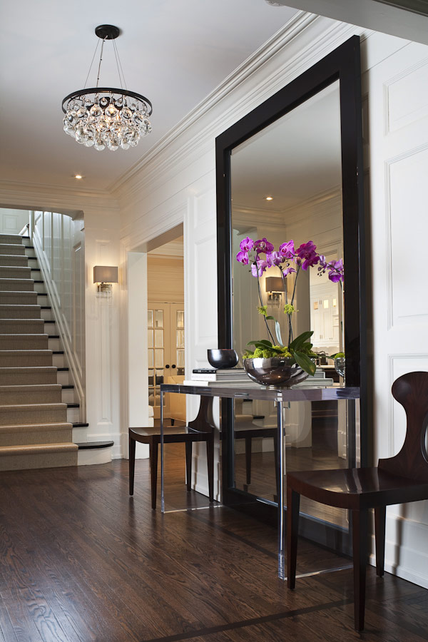Enter your home to a oversized mirror.