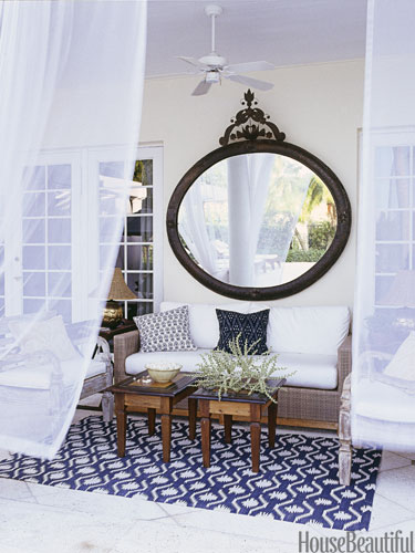 Bring in a mirror to an outdoor space to reflect greenery in any seating area!