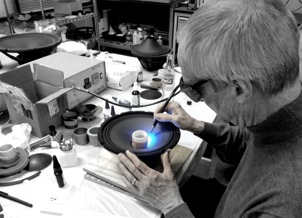 Bob Gallien getting his hands dirty testing glues for speaker manufacturing.