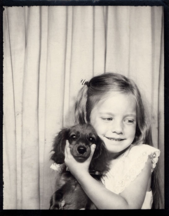 Girl with beloved pet dog