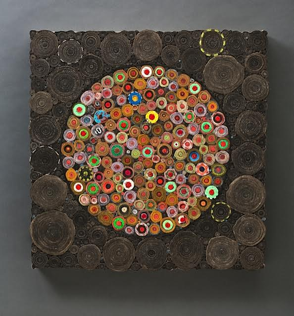 Paradigm Shift • 24 X 24 X 3 • reclaimed dartboard paper on board