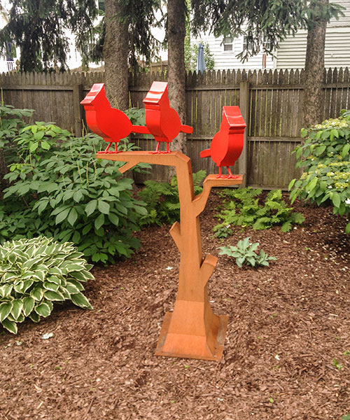 "Three Cardinals in a Tree  67"" X 40"" X 23""  cor-ten steel"