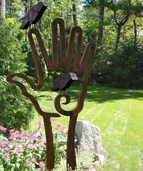 Bird in Hand (Crows)   9′ 7″ H x 4′ 10″ W x 5″ D cor-ten steel & painted steel cardinals or crows