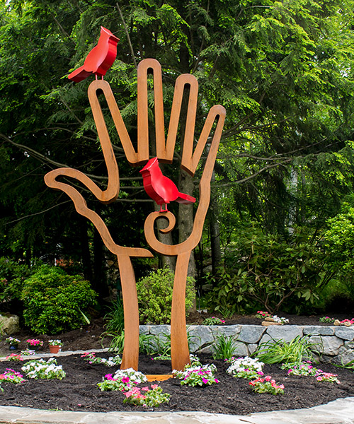"Bird in Hand (Cardinal) • 108"" X 58"" X 5"" • Cor-Ten Steel"