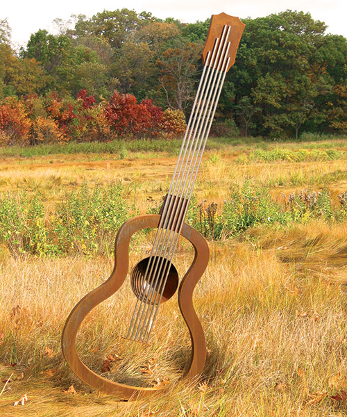 "Guitar • 7'9"" H x 3'0"" W x 8"" D • Cor-Ten Steel and Stainless Steel Rods"