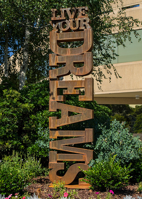 "Live Your Dreams   7'11"" H x 1'10"" W x 8"" D cor-ten steel"