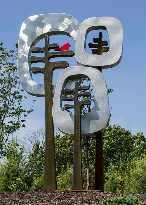 "Retro Trees • 7'9"" H x 4'6"" W x 2'6"" D • Cor-Ten & Stainless Steel with Painted Steel Cardinal"