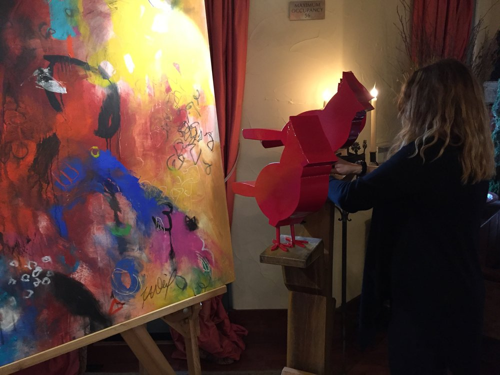 ArtHaus owner Julie Jenkins installs sculpture by Dale Rogers and painting by Emily Weil at Hotel Los Gatos