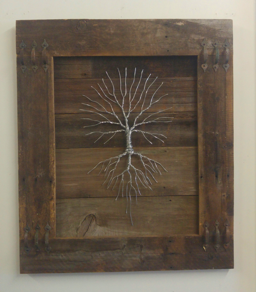 Grip on Reality • 40 X 34 • wood, wire, reclaimed handles • $825