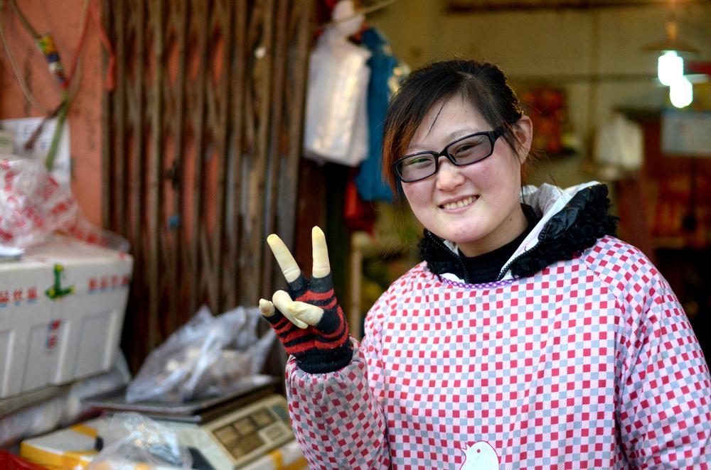 My friend Ms. Gai who runs my favorite vegetable market