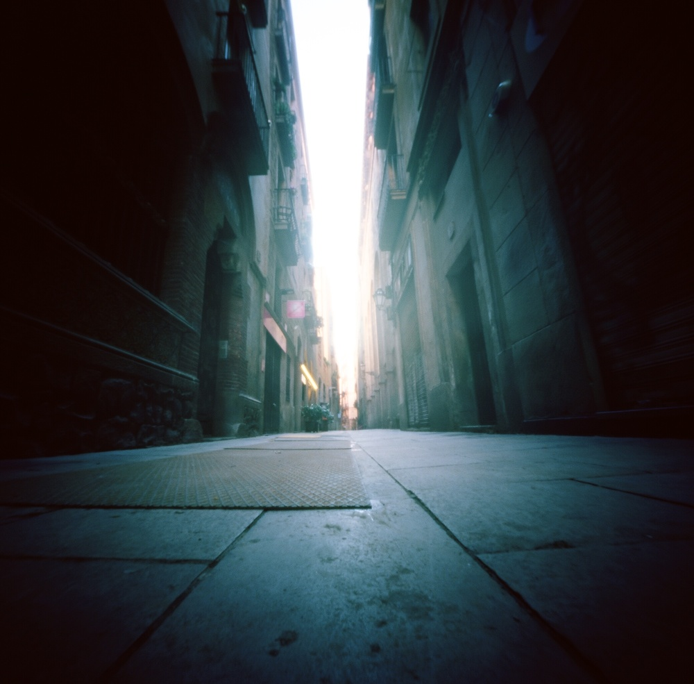 This image was made on Pinhole Day as we strolled through the streets. I had my  ONDU  6x6 on the floor and pointed up. It captures just one of the many long, narrow streets of Barcelona.