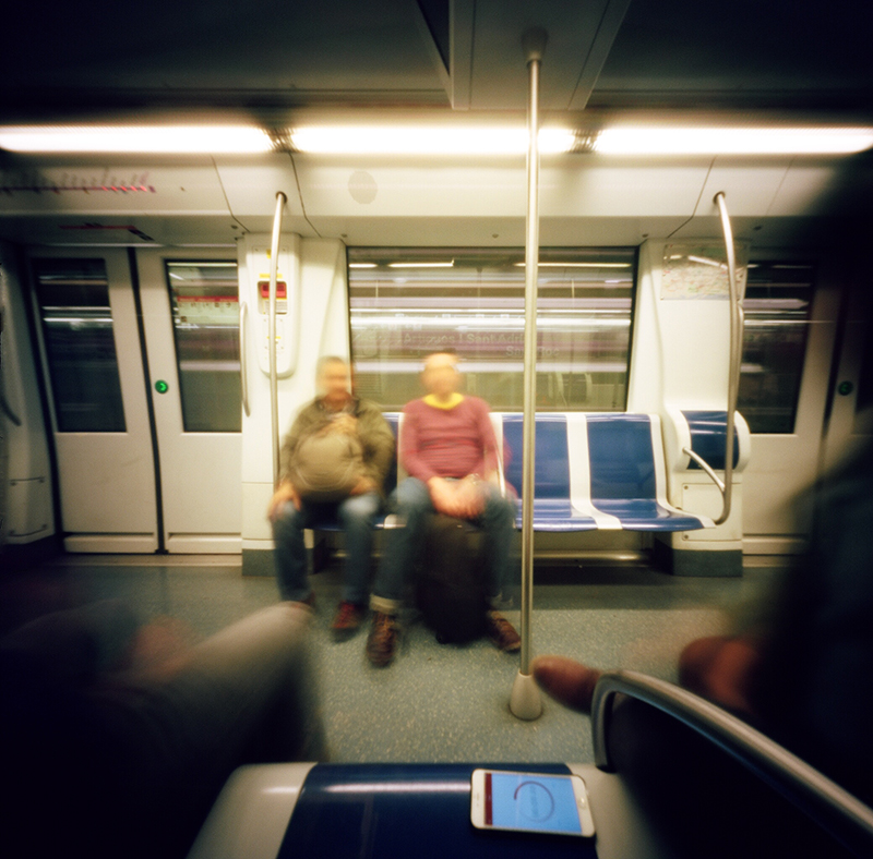 An image taken on the Barcelona metro with  Markus , Jesus and  Alex . Note the Pinhole Assist app on my phone keeping time for my exposure.