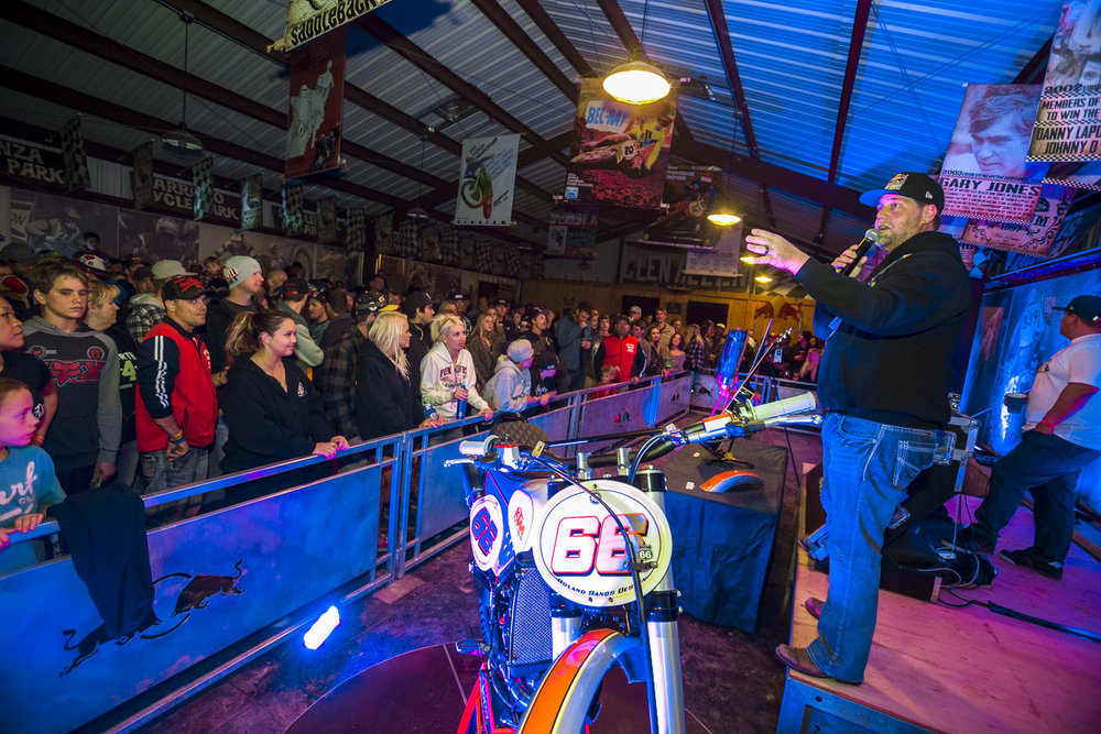 The auctioneer and the Caselli custom bike.